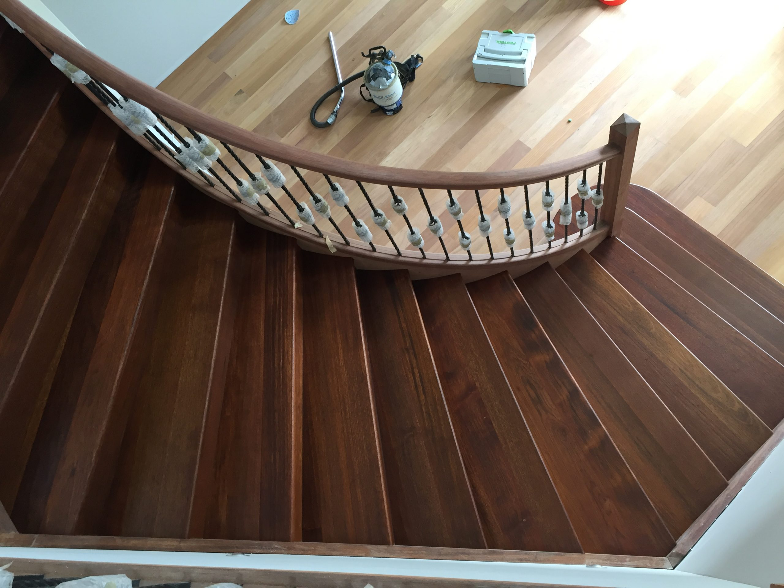 https://coastflooring.co.nz/wp-content/uploads/2020/05/New-Kwila-stairs-with-Moisture-cure-Polyurethane-finish-scaled.jpg